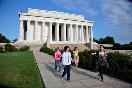 Visitors leave the Lincoln Memorial in Washington, Friday, July 26, 2013, after the U.S. Park Police closed it off after someone splattered green paint on the statue and the floor area of the memorial.