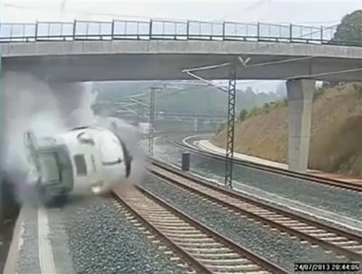 This image taken from security camera video shows a train derailing in Santiago de Compostela, Spain, on Wednesday, July 24, 2013.