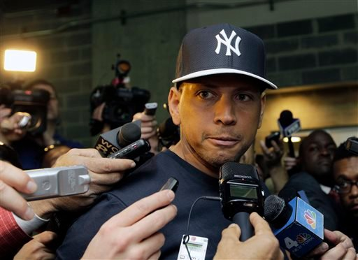 In this April 1, 2013, file photo, New York Yankees' Alex Rodriguez talks to reporters outside the Yankees' clubhouse in New York.