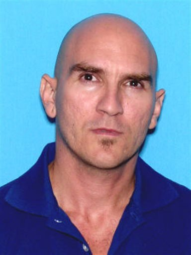 Pedro Vargas went on a shooting rampage throughout his apartment building, killing six people before being shot to death by police, Saturday July 27, 2013. (AP Photo/Hialeah Police Department)