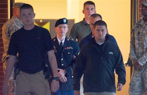 Army Pfc. Bradley Manning is escorted out of a courthouse at Fort Mead, Md, Friday, July 26, 2013. (AP Photo/Cliff Owen)