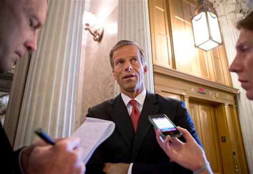 Sen. John Thune, R-S.D., chair of the Senate Republican Caucus, speaks with reporters just before the final vote on whether to reverse the recent hike in rates for government student loans, at the Capitol in Washington, Wednesday, July 24, 2013.