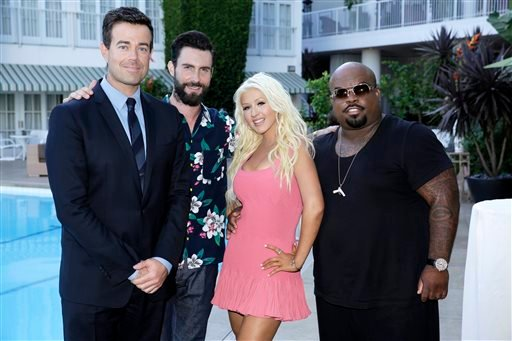 "This image released by NBC shows, from left, Carson Daly, Adam Levine, Christina Aguilera, and CeeLo Green at a cocktail reception for ""The Voice"" in Beverly Hills, Calif., on Saturday, July 27, 2013. (AP Photo/NBC, Paul Drinkwater)"