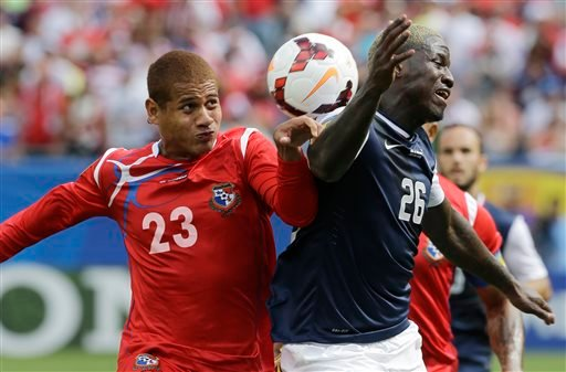 Panama's Roberto Chen, left, and United States' Eddie Johnson battle for the ball during the second half of the CONCACAF Gold Cup final Soccer match at Soldier Field, Sunday, July 28, 2013, in Chicago.