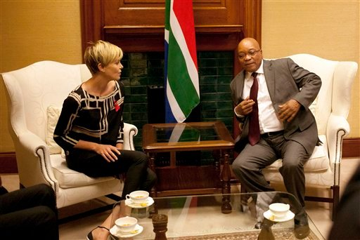 South African President Jacob Zuma, right, meets South African-born Hollywood actress Charlize Theron, left, at his Union Building office in Pretoria, South Africa, Monday, 29 July 2013.