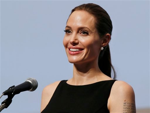"""Angelina Jolie delivers a statement before screening the film """"In the Land of Blood and Honey"""" directed by her, at the United Nations University in Tokyo Monday, July 29, 2013. (AP Photo/Koji Sasahara)"""