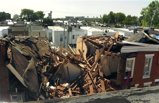 This Monday, July 29, 2013, photo, shows a row house collapsed following an explosion in South Philadelphia on Monday, July 29 2013. (AP)