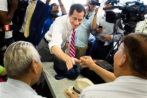New York City mayoral candidate Anthony Weiner shakes hands with voters during a campaign stop at the Nan Shan Senior Center, Monday, July 29, 2013, in the Queens borough of New York. (AP)