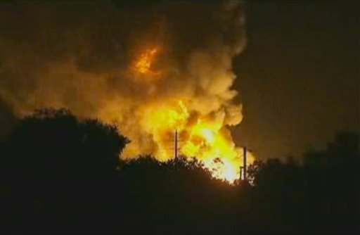 In this image taken from Associated Press video, flames rise from an explosion at the Blue Rhino propane plant in Tavares City, Fla., late Monday, July 29, 2013.