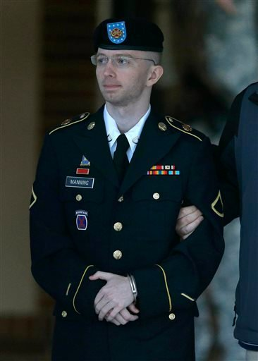 In this Monday, July 29, 2013 file photo, Army Pfc. Bradley Manning is escorted to a security vehicle outside of a courthouse in Fort Meade, Md.