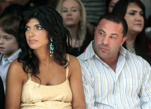"This Sept. 13, 2009 file photo originally released by Oral-B Pulsonic shows ""Real Housewives of New Jersey"" stars, Teresa Giudice, left, and her husband Joe Giudice at the Caravan Fashion Show sponsored by Oral-B Pulsonic in New York."