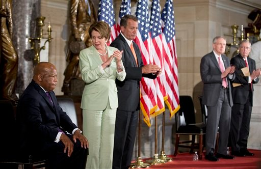Rep. John Lewis, D-Ga., left, is recognized during a ceremony on Capitol Hill in Washington, Wednesday, July 31, 2013, in observance of the 50th anniversary of the March on Washington for Jobs and Freedom. (AP)