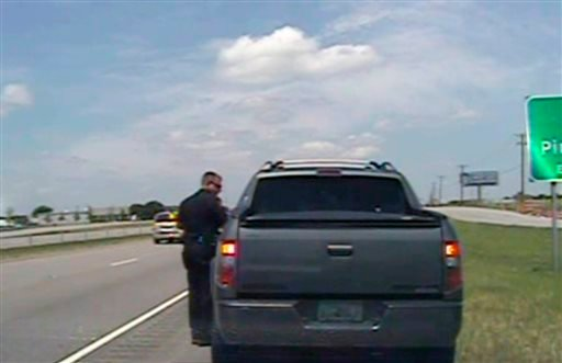 In this image taken from dashcam video provided by the City of Forney Police Department, a police officer speaks with George Zimmerman. (AP)