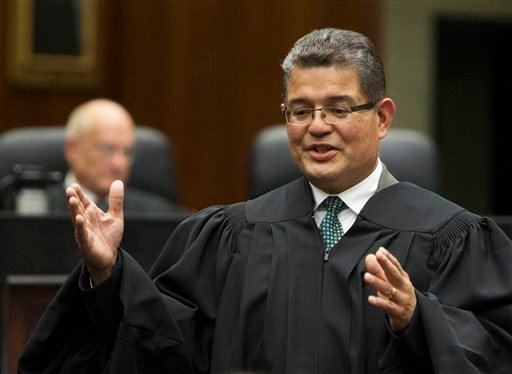 FILE - In this July 2, 2013 file photo, Ruben Castillo, the new chief judge of the U.S. District Court in Chicago, gives concluding remarks after being sworn in as chief judge. (AP)