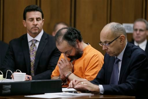 Ariel Castro, center, adjusts his glasses during the sentencing phase Thursday, Aug. 1, 2013, in Cleveland.