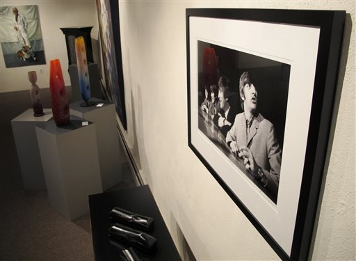 This July 27, 2013 image shows a photograph of the Beatles taken in 1964 by photographer Mike Mitchell on exhibit at the David Anthony Fine Art gallery in Taos, N.M.