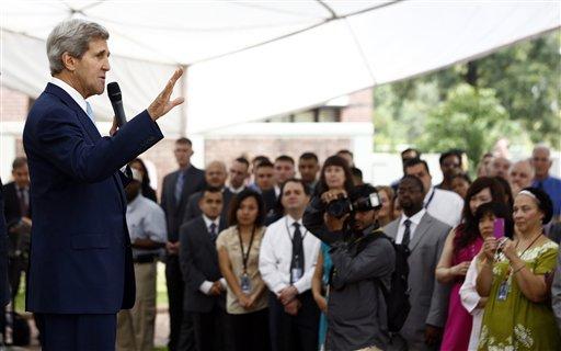U.S. Secretary of State John Kerry, left, speaks to staff members at the U.S. Embassy in Islamabad, Pakistan Thursday, Aug. 1, 2013.