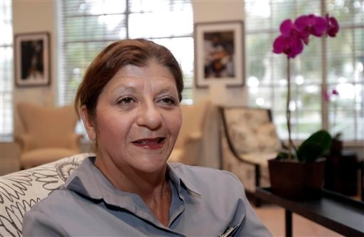 In this photo taken Wednesday, July 17, 2013, Yolanda Oruc is shown in the lobby of the Betsy Hotel in the South Beach area of Miami Beach, Fla.