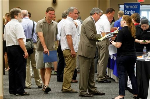 This July 15, 2013 photo, people line up at the job fair in South Burlington, Vt. The 162,000 jobs the economy added in July were a disappointment.