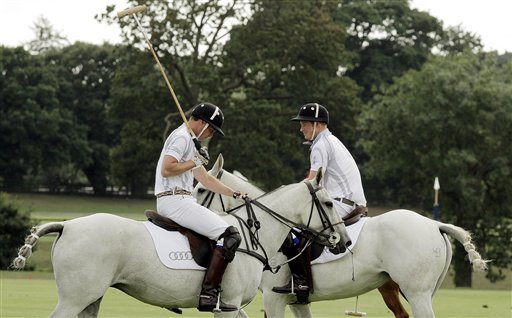 Britain's Duke of Cambridge, Prince William, left, and Prince Harry during the Audi Polo Challenge charity polo match, at Coworth Park, near Ascot, England, Saturday Aug. 3, 2013.