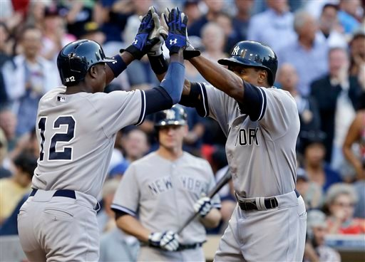 New York Yankees' Curtis Granderson , right, and Alfonso Soriano high five after Granderson's two-run home run against the San Diego Padres in the seventh inning of an interleague baseball game in San Diego, Saturday, Aug. 3, 2013.