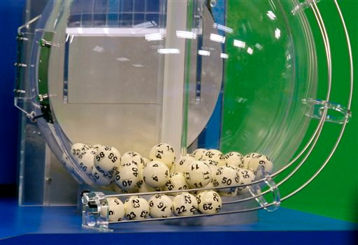 In this Nov. 28, 2012, file photo, Powerball numbers are chosen in the $579.9-million game drawing at the Florida Lottery in Tallahassee, Fla.