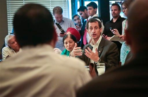 New York mayoral candidate Anthony Weiner, center, speaks during a meeting with leaders from the South and East Asian communities in Queens, on Friday Aug. 2, 2013, in New York.