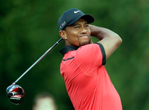 Tiger Woods watches his tee shot on the fourth hole during the final round of the Bridgestone Invitational golf tournament Sunday, Aug. 4, 2013 at Firestone Country Club in Akron, Ohio. (AP Photo/Mark Duncan)