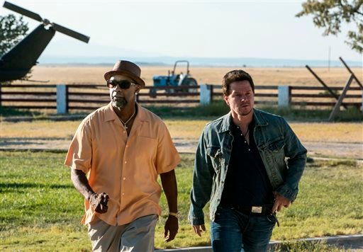 """This image released by Universal Pictures shows Denzel Washington, left, and Mark Wahlberg in a scene from """"2 Guns."""" (AP Photo/Universal Pictures, Patti Perret)"""