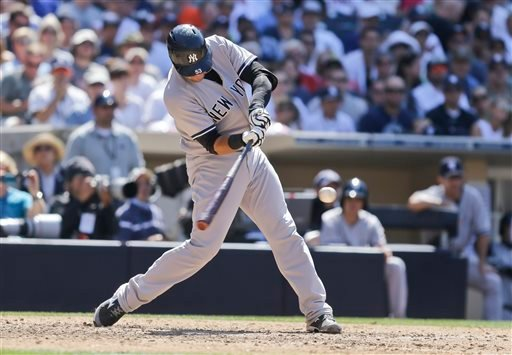 New York Yankees' Austin Romine connects for a home run against the San Diego Padres in the seventh inning of a baseball game in San Diego, Sunday, Aug. 4, 2013. (AP Photo/Lenny Ignelzi)