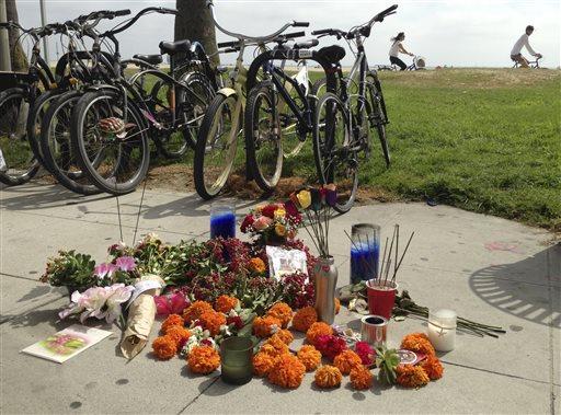 A makeshift memorial along the Venice, Calif., beach boardwalk is shown Sunday Aug. 4, 2013.