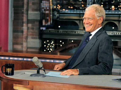 "In this July 16, 2013 file photo, host David Letterman smiles on the set of the ""Late Show with David Letterman."""