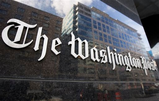 In this Feb. 27, 2008, file photo, The Washington Post sign is seen on its building in Washington.