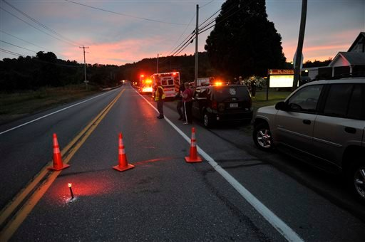 Emergency crews respond to a reported shooting at the Ross Township building that left two people dead, Monday, Aug. 5, 2013 in Saylorsburg, Pa. (AP)