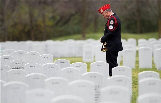 In this Saturday, Nov. 14, 2009, file photo, a military bugler waits for the funeral procession of Pfc. Michael Pearson to arrive at the Abraham Lincoln National Cemetery in Elwood, Ill.