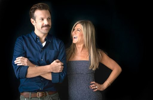 "In this July 27, 2013 file photo, actor Jason Sudeikis, left, and actress Jennifer Aniston pose for a portrait as they promote the movie ""We're the Millers"" in New York. The film opens nationwide on Wednesday, Aug. 7."