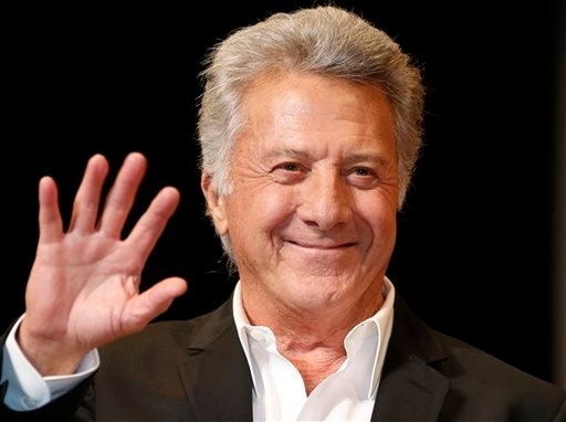 "FILE - In this April 8, 2013 file photo, actor Dustin Hoffman waves to fans during the Japan Premiere of his film, ""Quartet,"" in Tokyo. (AP)"