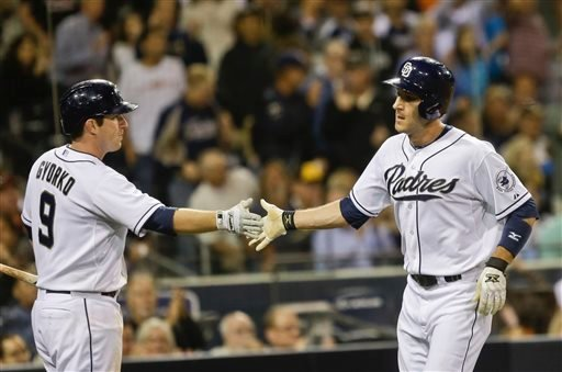San Diego Padres' Chris Denorfia, right, is congratulated by Jedd Gyorko after scoring against the Baltimore Orioles in the sixth inning of a baseball game in San Diego, Tuesday, Aug. 6, 2013. (AP Photo/Lenny Ignelzi)