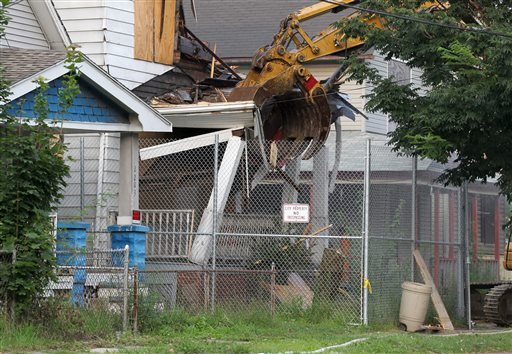 The home of Ariel Castro is torn down in Cleveland on Wednesday, Aug. 7, 2013.