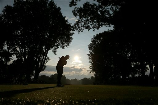 Robert Garrigus tees off on the 10th hole during the first round of the PGA Championship golf tournament at Oak Hill Country Club, Thursday, Aug. 8, 2013, in Pittsford, N.Y. (AP Photo/Charlie Riedel)