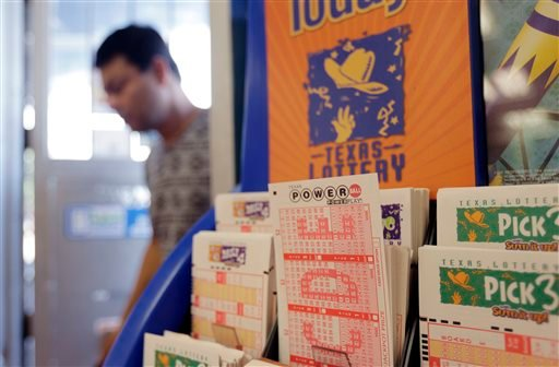 Powerball lottery forms are seen, Wednesday, Aug. 7, 2013, in San Antonio. (AP Photo/Eric Gay)