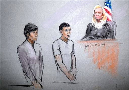 FILE--This courtroom sketch of May 1, 2013 by artist Jane Flavell Collins shows defendants Dias Kadyrbayev, left, and Azamat Tazhayakov appearing in front of Federal Magistrate Marianne Bowler at the Moakley Federal Courthouse in Boston. (AP)