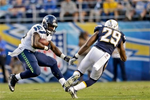 Seattle Seahawks running back Christine Michael puts a move on San Diego Chargers defensive back William Middleton in the second quarter of an NFL preseason football game Thursday, Aug. 8, 2013, in San Diego.