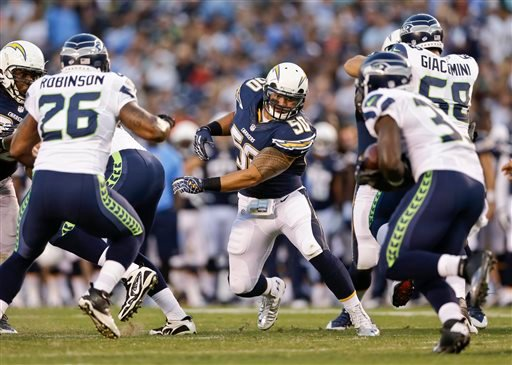 San Diego Chargers inside linebacker Manti Te'o takes aim on Seattle Seahawks running back Christine Michael in the second quarter of an NFL preseason football game.