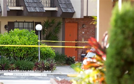 Police tape blocks the entrance to a murder scene in Miami, Thursday, Aug. 8, 2013. (AP Photo/J Pat Carter)