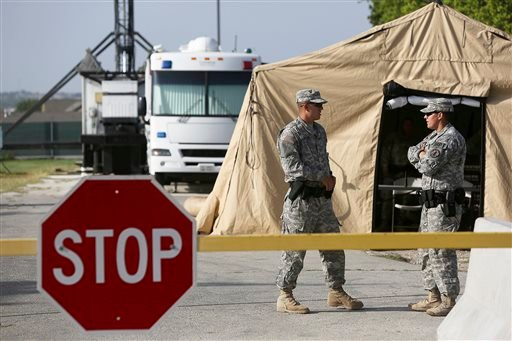 Soldiers guard a security checkpoint outside the Lawrence H. Williams Judicial Center on the second day of the trial for Maj. Nidal Hasan at Fort Hood, Texas on Wednesday, Aug. 7, 2013.