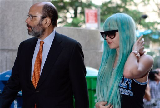 In this Tuesday, July 9, 2013 file photo, Amanda Bynes, accompanied by attorney Gerald Shargel, arrives for a court appearance in New York on allegations that she chucked a marijuana bong out the window of her 36th-floor Manhattan apartment.