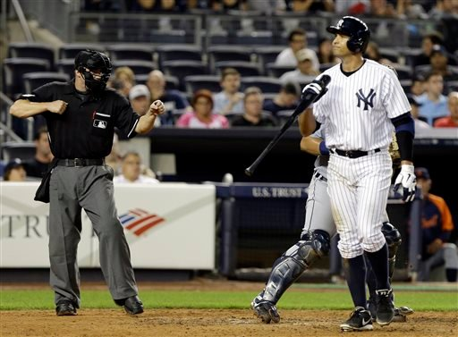 New York Yankees' Alex Rodriguez walks back to the dugout after striking out during the eighth inning of a baseball game against the Detroit Tigers Friday, Aug. 9, 2013, in New York. (AP Photo/Frank Franklin II)