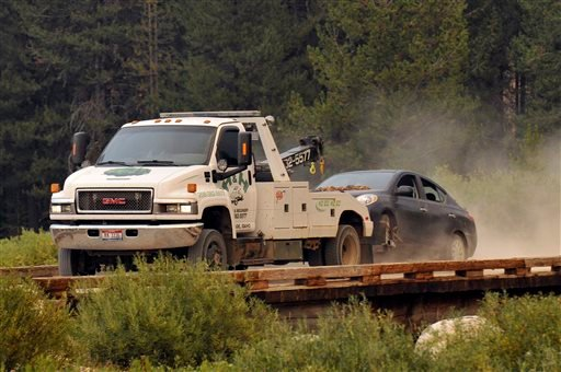 James Dimaggio's car is towed to the town of Cascade after dectives finished searsching it on a trail head bordering the Frank Church River of No Return Wilderness on Saturday, Aug. 10, 2013.