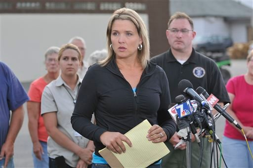 ADA County Sheriff's Office Public Information Officer Andrea Dearden addresses the media at the Cascade Fire Station in Cascade, Idaho, Saturday, Aug. 10, 2013.